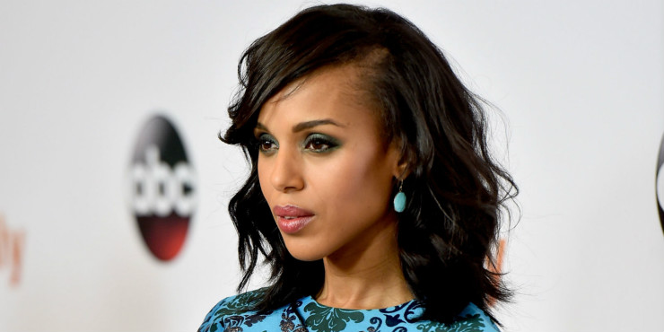 Kerry's loose curls are swooped to the side, letting the attention fall on her blue monochromatic outfit.