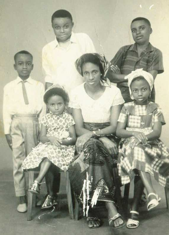 Dupsy: My family and I in Nigeria; women would often wear hair scarves.